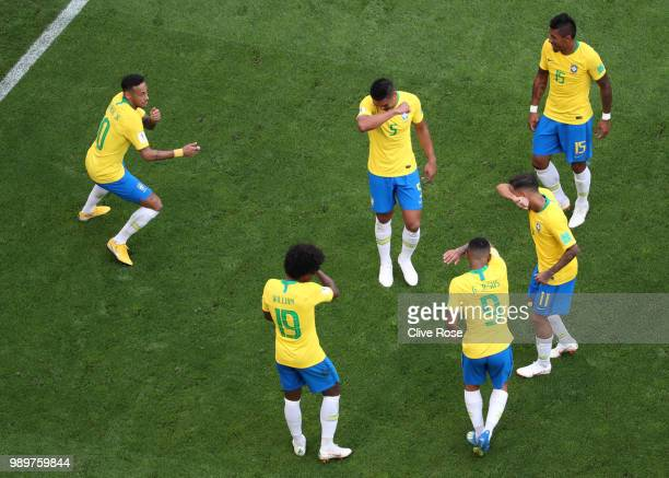 Neymar Jr of Brazil celebrates with teammates after scoring his team's first goal during the 2018 FIFA World Cup Russia Round of 16 match between...
