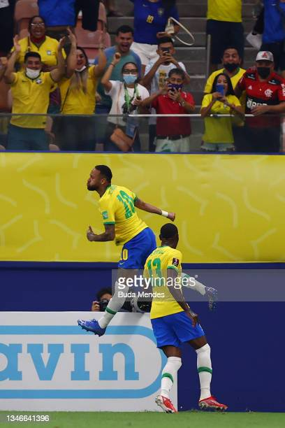 Neymar Jr. Of Brazil celebrates with teammates after scoring the first goal of his team during a match between Brazil and Uruguay as part of South...