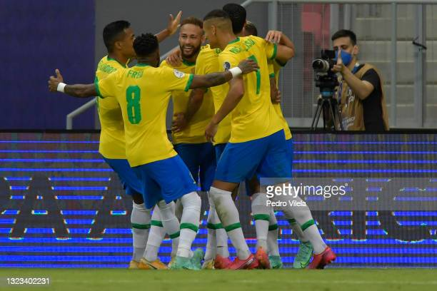Neymar Jr. Of Brazil celebrates with teammates after scoring the second goal of his team during a Group B match between Brazil and Venezuela as part...
