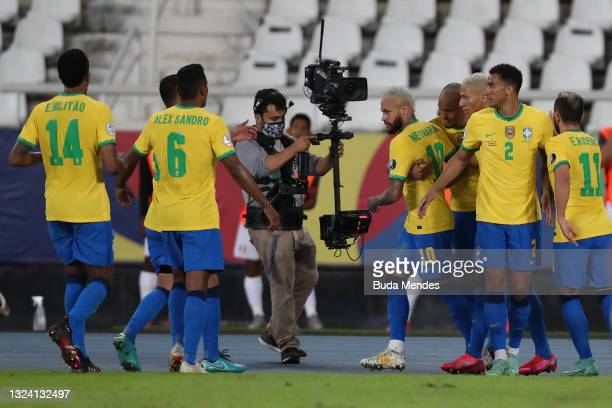 Neymar Jr. Of Brazil celebrates with teammates after scoring the second goal of his team during a match between Brazil and Peru as part of Group B of...