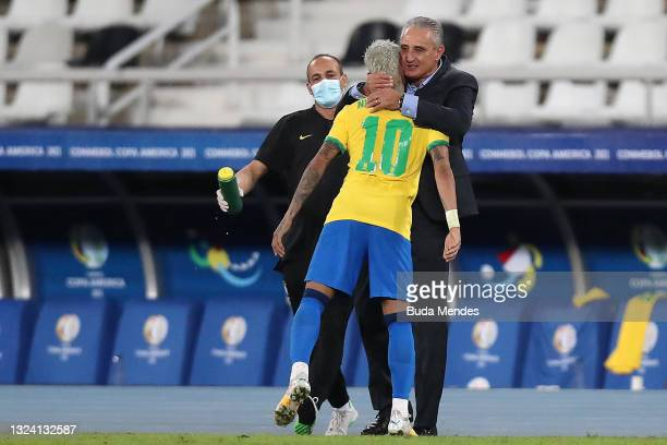 Neymar Jr. Of Brazil celebrates with Tite head coach of Brazil after scoring the second goal of his team during a match between Brazil and Peru as...