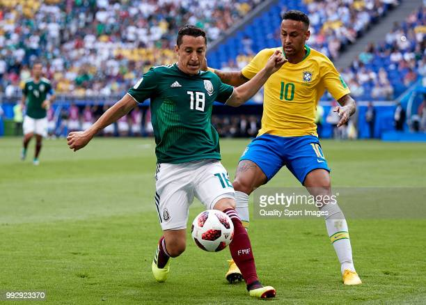 Neymar Jr of Brazil competes for the ball with Andres Guardado of Mexico during the 2018 FIFA World Cup Russia Round of 16 match between Brazil and...