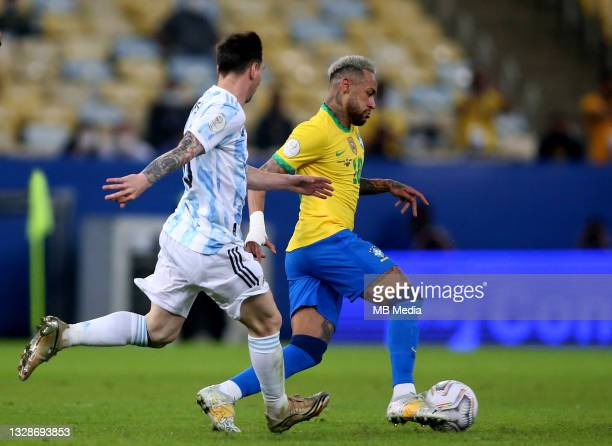 Neymar Jr of Brazil competes for the ball with Lionel Messi of Argentina ,during the Final Match of Copa America Brazil 2021 between Brazil and...