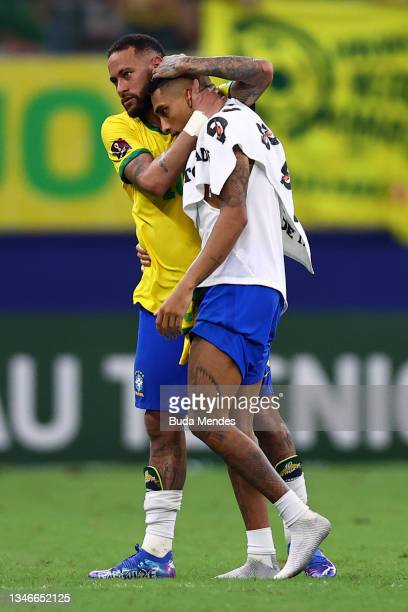 Neymar Jr. Of Brazil embraces Raphinha after winning a match between Brazil and Uruguay as part of South American Qualifiers for Qatar 2022 at Arena...