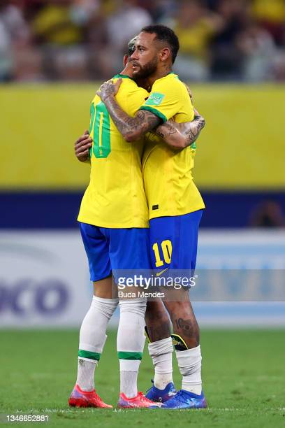 Neymar Jr. Of Brazil embraces teammate Antony after winning a match between Brazil and Uruguay as part of South American Qualifiers for Qatar 2022 at...