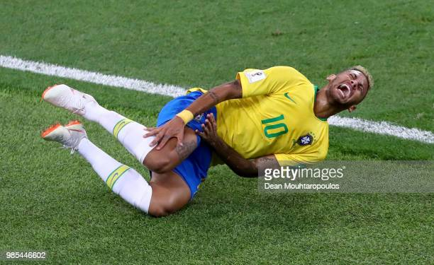 Neymar Jr of Brazil falls down after being fouled during the 2018 FIFA World Cup Russia group E match between Serbia and Brazil at Spartak Stadium on...