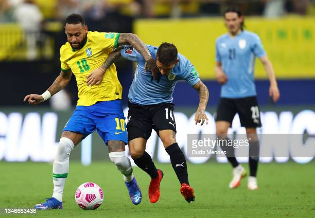 Neymar Jr. Of Brazil fights for the ball with Lucas Torreira of Uruguay during a match between Brazil and Uruguay as part of South American...