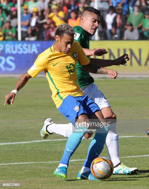 Neymar Jr of Brazil fights for the ball with Luis Gutierrez of Brazil during a match between Bolivia and Brazil as part of FIFA 2018 World Cup...