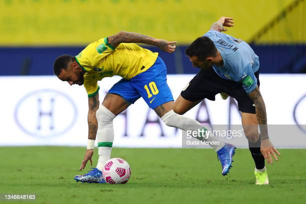 Neymar Jr. Of Brazil fights for the ball with Matias Vecino of Uruguay during a match between Brazil and Uruguay as part of South American Qualifiers...