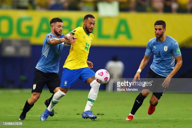 Neymar Jr. Of Brazil fights for the ball with Nahitan Nandez and Rodrigo Bentancur of Uruguay during a match between Brazil and Uruguay as part of...
