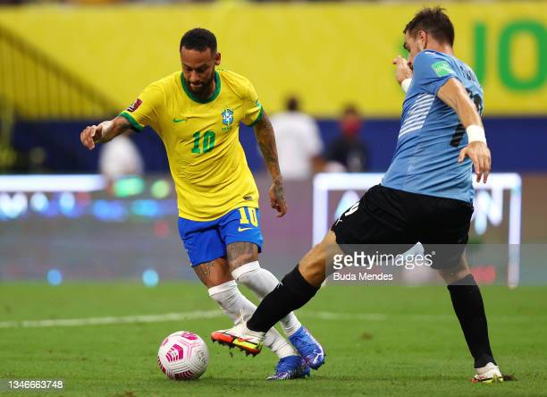 Neymar Jr. Of Brazil fights for the ball with Sebastian Coates of Uruguay during a match between Brazil and Uruguay as part of South American...