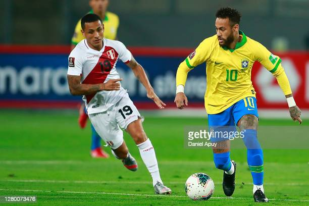 Neymar Jr. Of Brazil fights for the ball with Yoshimar Yotún of Peru during a match between Peru and Brazil as part of South American Qualifiers for...