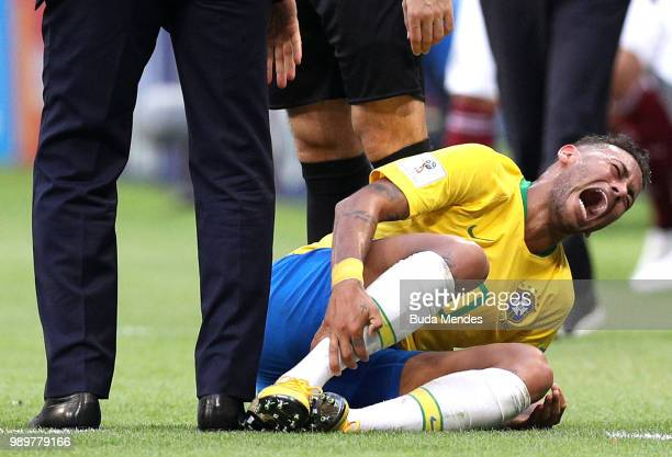 Neymar Jr of Brazil goes down injured during the 2018 FIFA World Cup Russia Round of 16 match between Brazil and Mexico at Samara Arena on July 2...