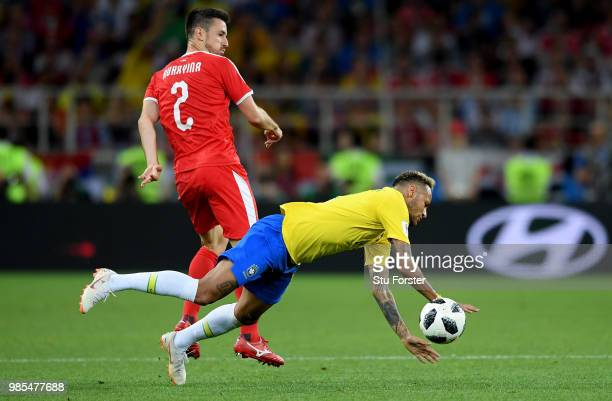 Neymar Jr of Brazil goes down under a challenge from Antonio Rukavina of Serbia during the 2018 FIFA World Cup Russia group E match between Serbia...