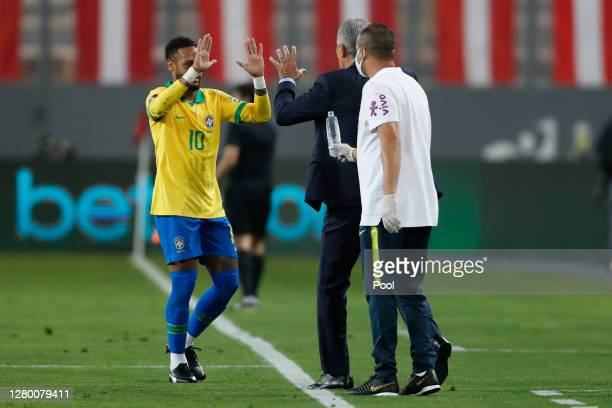 Neymar Jr. Of Brazil greets Tite during a match between Peru and Brazil as part of South American Qualifiers for Qatar 2022 at Estadio Nacional de...
