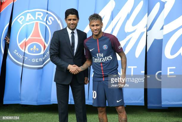 Neymar Jr of Brazil - here with President of PSG Nasser Al-Khelaifi - during press conference and jersey presentation following his signing as new...