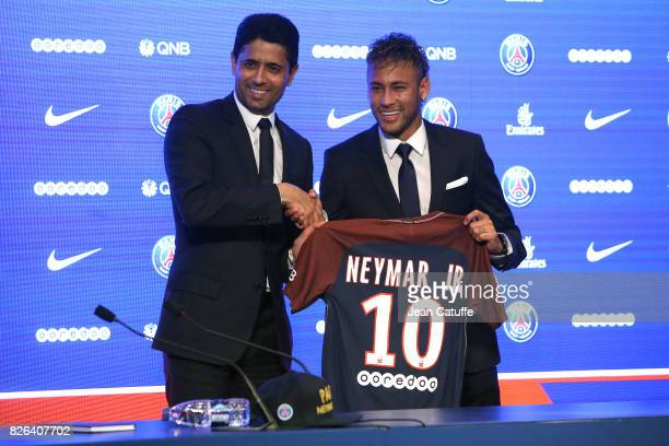 Neymar Jr of Brazil here with President of PSG Nasser AlKhelaifi during press conference and jersey presentation following his signing as new player...