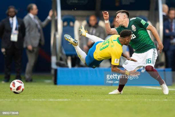 Neymar Jr of Brazil holds off Andres Guardado of Mexico during the 2018 FIFA World Cup Russia Round of 16 match between Brazil and Mexico at Samara...