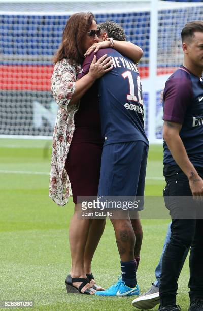 Neymar Jr of Brazil hugs his mother Nadine Santos following press conference and jersey presentation after his signing as new player of Paris...