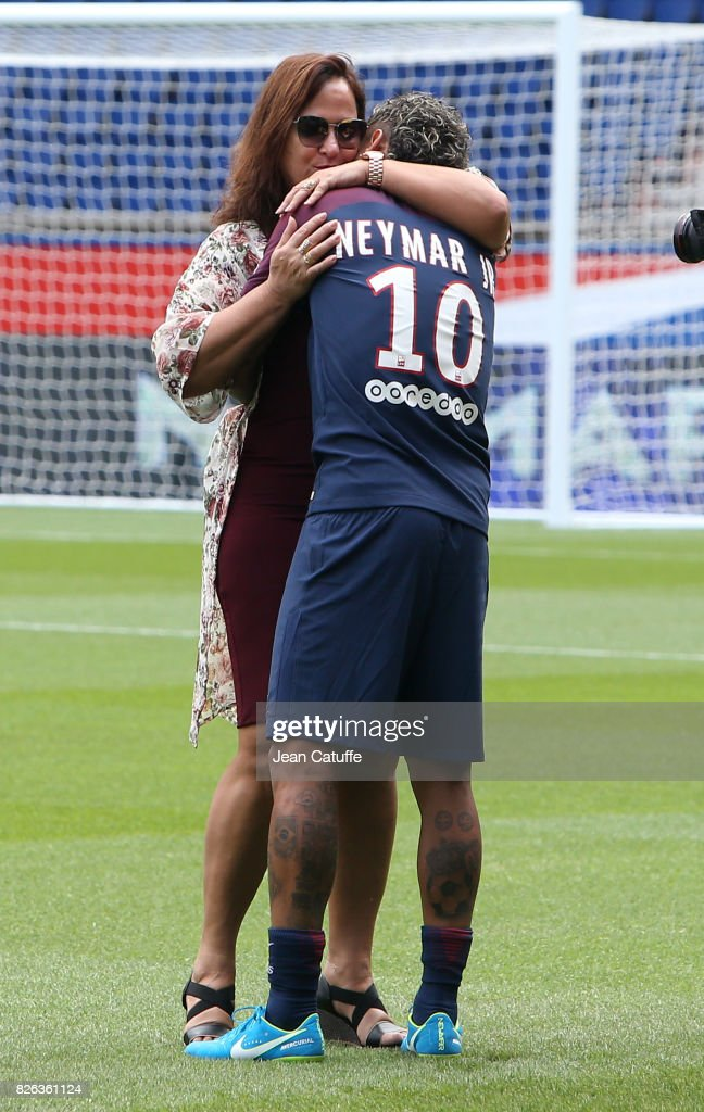 Neymar Jr of Brazil hugs his mother Nadine Santos following press conference and jersey presentation after his signing as new player of Paris Saint-Germain at Parc des Princes on August 4, 2017 in Paris, France.