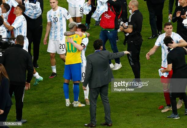 Neymar Jr. Of Brazil hugs Lionel Messi of Argentina after the final of Copa America Brazil 2021 between Brazil and Argentina at Maracana Stadium on...
