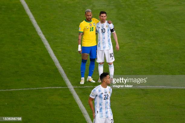 Neymar Jr. Of Brazil hugs Lionel Messi of Argentina as Lautaro Martinez of Argentina prepares for kick off prior to the final of Copa America Brazil...