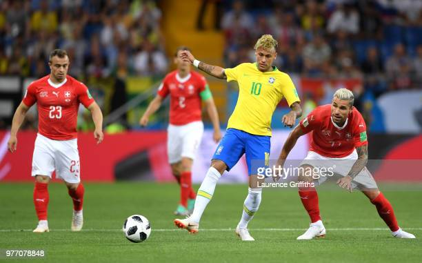 Neymar Jr of Brazil in action as Xherdan Shaqiri and Valon Behrami of Switzerland close him down to the 2018 FIFA World Cup Russia group E match...