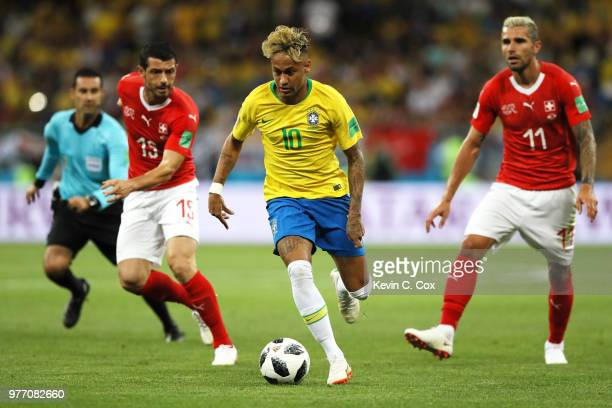 Neymar Jr of Brazil is challenged by Ricardo Rodriguez and Valon Behrami of Switzerland of Switzerland during the 2018 FIFA World Cup Russia group E...