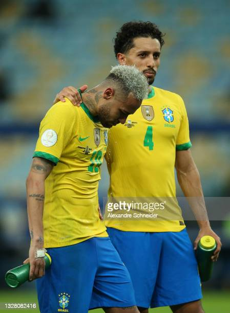 Neymar Jr. Of Brazil is comforted by teammate Marquinhos after the final of Copa America Brazil 2021 between Brazil and Argentina at Maracana Stadium...