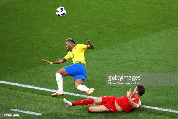 Neymar Jr of Brazil is fouled by Adem Ljajic of Serbia during the 2018 FIFA World Cup Russia group E match between Serbia and Brazil at Spartak...