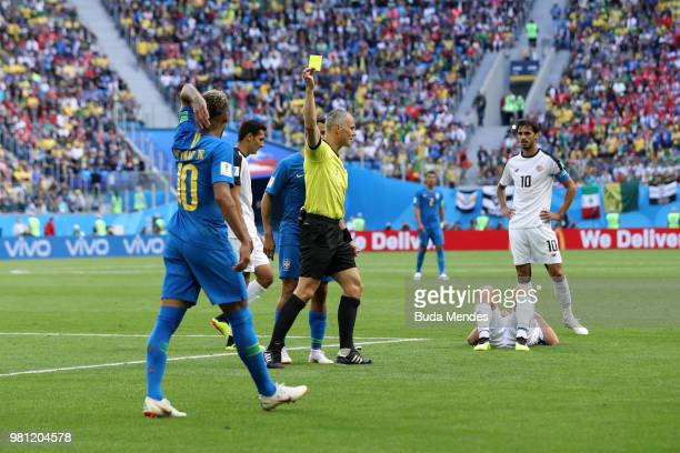 Neymar Jr of Brazil is shown a yellow card by referee Bjorn Kuipers during the 2018 FIFA World Cup Russia group E match between Brazil and Costa Rica...