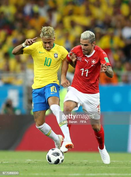 Neymar Jr of Brazil is tackled by Valon Behrami of Switzerland during the 2018 FIFA World Cup Russia group E match between Brazil and Switzerland at...