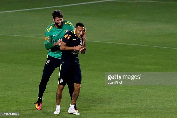 Neymar Jr of Brazil jokes around with teammate Allison during a training session at Nacional Stadium on November 14 2016 in Lima Peru Brazil will...