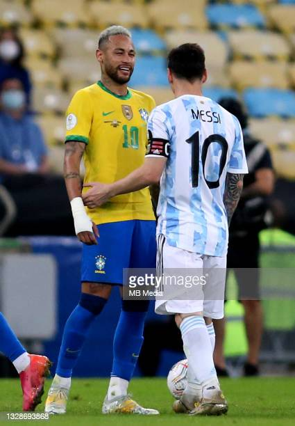Neymar Jr of Brazil jokes with Lionel Messi of Argentina ,during the Final Match of Copa America Brazil 2021 between Brazil and Argentina at Maracana...