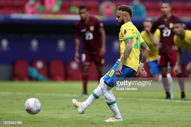 Neymar Jr. Of Brazil kicks a penalty to score the second goal of his team during a Group B match between Brazil and Venezuela as part of Copa America...
