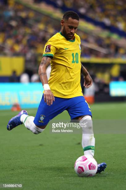 Neymar Jr. Of Brazil kicks the ball during a match between Brazil and Uruguay as part of South American Qualifiers for Qatar 2022 at Arena Amazonia...