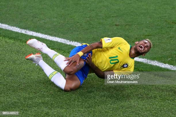 Neymar Jr of Brazil lies on the pitch after being fouled during the 2018 FIFA World Cup Russia group E match between Serbia and Brazil at Spartak...