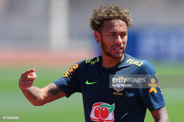 Neymar Jr of Brazil looks on during a Brazil training session ahead of the FIFA World Cup 2018 at YugSport Stadium on June 12 2018 in Sochi Russia