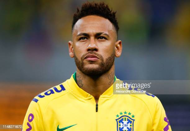 Neymar Jr of Brazil looks on during the national anthem before the friendly match against Qatar at Mane Garrincha Stadium on June 05 2019 in Brasilia...