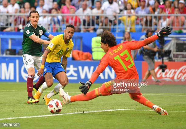 Neymar Jr of Brazil passes the ball to Roberto Firmino of Brazil for Brazil's second goal during the 2018 FIFA World Cup Russia Round of 16 match...