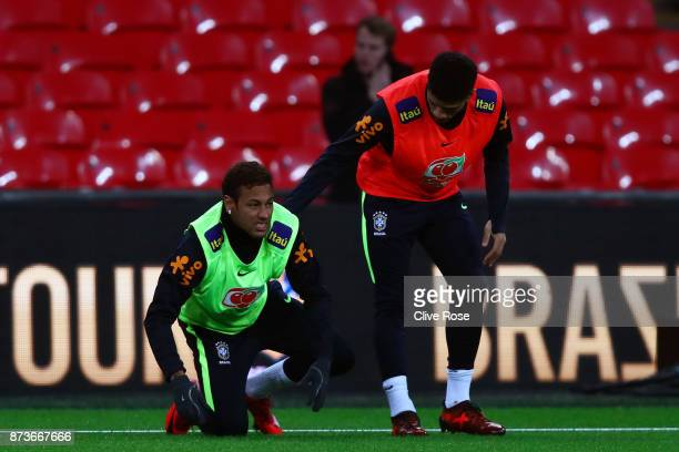 Neymar Jr of Brazil reacts after a slip during a Brazil training session ahead of the International Friendly Match between England and Brazil on...