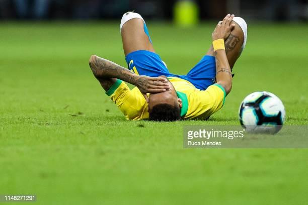 Neymar Jr of Brazil reacts after an injury during the International Friendly Match between Brazil and Qatar at Mane Garrincha Stadium on June 5 2019...