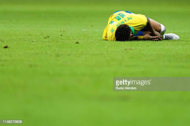 Neymar Jr of Brazil reacts after an injury reacts during the International Friendly Match between Brazil and Qatar at Mane Garrincha Stadium on June...