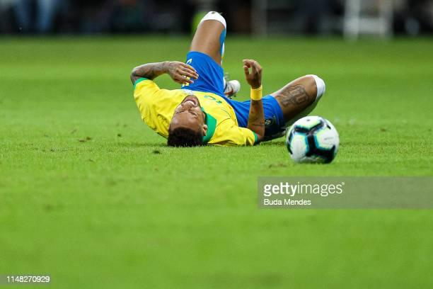 Neymar Jr of Brazil reacts after an injury reacts during the International Friendly Match between Brazil and Qatar at Mane Garrincha Stadium on June...