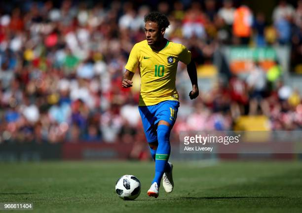 Neymar Jr of Brazil runs with the ball during the International Friendly match between Croatia and Brazil at Anfield on June 3 2018 in Liverpool...