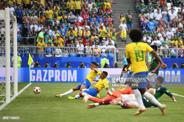 Neymar Jr of Brazil scores his team's first goal during the 2018 FIFA World Cup Russia Round of 16 match between Brazil and Mexico at Samara Arena on...