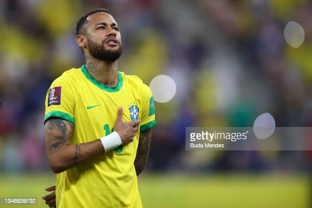 Neymar Jr. Of Brazil sings the national anthem prior to a match between Brazil and Uruguay as part of South American Qualifiers for Qatar 2022 at...