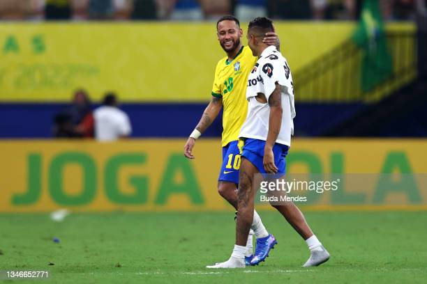 Neymar Jr. Of Brazil smiles with teammate Raphinha after winning a match between Brazil and Uruguay as part of South American Qualifiers for Qatar...