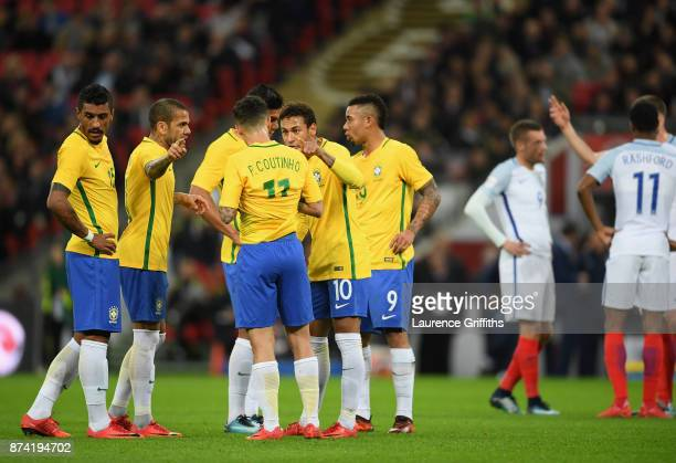 Neymar Jr of Brazil speaks to Philippe Coutinho of Brazil during the international friendly match between England and Brazil at Wembley Stadium on...