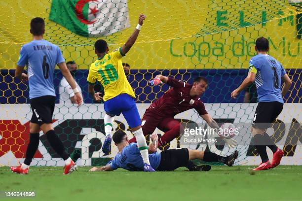 Neymar Jr. Of Brazil takes a shot on target against Fernando Muslera of Uruguay during a match between Brazil and Uruguay as part of South American...
